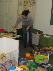 Frankie Masters, a United Way Day of Caring volunteer from Avery Dennison, sorts blocks into  piles as part of her team's project to clean up the playroom at Forbes House.