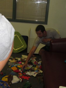 Josh Bogner of Avery Dennison reaches for the second part of a plastic toy at Forbes House on the United Way Day of Caring on June 25.