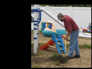 Volunteer Mike Webster moved out of the playroom and onto the playground once the rain clouds said good-bye.