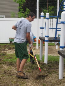 Avery Dennison employee Josh Bogner gives up sorting Legos in the playroom for raking up  weeds at Forbes House during the United Way Day of Caring on June 25th.