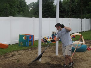 Volunteer Bryan Zelinski of Avery Dennison jumps into the fight against weeds at Forbes House  on the United Way Day of Caring on June 25th .